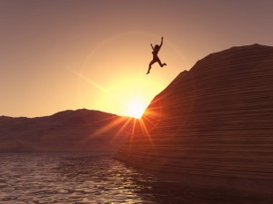 woman-jumping-from-cliff